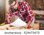 carpenter working on project | Shutterstock . vector #529473475