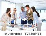 mature businessman with team... | Shutterstock . vector #529505485