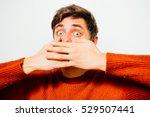 man closes a mouth hands   Shutterstock . vector #529507441