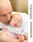 father holding crying baby girl. | Shutterstock . vector #529512511