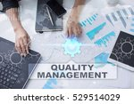 Small photo of Woman is working with documents, tablet pc and notebook and selecting quality management.