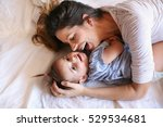 young mother playing with her... | Shutterstock . vector #529534681