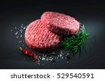 raw beef hamburger patties with ... | Shutterstock . vector #529540591