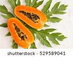 papaya fruit on wooden... | Shutterstock . vector #529589041