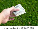 Small photo of close up hand hold money banknote in hand and give to customer or coruption