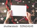 empty postcard in female hands. ... | Shutterstock . vector #529614145