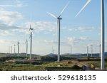 wind turbines on sunny morning | Shutterstock . vector #529618135