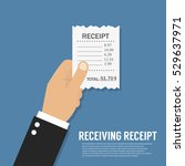 hand holding receipt | Shutterstock .eps vector #529637971