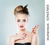 Small photo of Beautiful Blonde Woman Fashion Model with Empty Hand