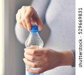 pregnant woman drinking watter... | Shutterstock . vector #529669831