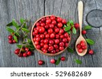 red lingonberry in wooden bowl... | Shutterstock . vector #529682689