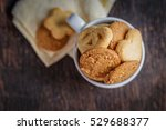 cookies in cup on a wooden table | Shutterstock . vector #529688377
