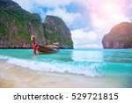 long boat and blue water at... | Shutterstock . vector #529721815