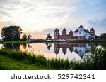 mir castle at sunset by the lake | Shutterstock . vector #529742341