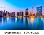 dubai skyline at dusk  uae. | Shutterstock . vector #529750231