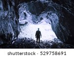 Man At Cave Entrance