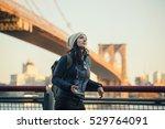 woman in new york city  | Shutterstock . vector #529764091