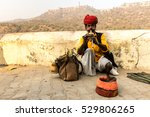 Man In Turban Playing Flute In...