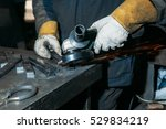 sparks from metal polishing by... | Shutterstock . vector #529834219