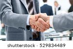 business man shaking hand to... | Shutterstock . vector #529834489