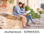 ethnically diverse couple... | Shutterstock . vector #529845331
