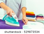 closeup of woman ironing... | Shutterstock . vector #529873534