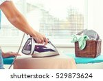 closeup of woman ironing... | Shutterstock . vector #529873624