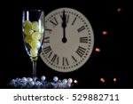Small photo of CELEBRATION OF THE NEW YEAR, TRADITION OF TWELVE GRAPES OF LUCK WITH THE CLOCK WITH TWELVE BELLS
