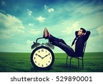 Stock photo young business man corporate executive relaxing sitting on a chair in the open air outdoors 529890001