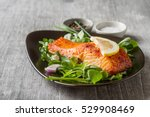one piece of baked salmon... | Shutterstock . vector #529908469