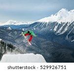 jumping snowboarder keeps one... | Shutterstock . vector #529926751