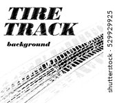 black grunge tire track with... | Shutterstock .eps vector #529929925
