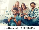 excited friends playing video... | Shutterstock . vector #530002369