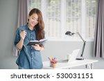 indoor picture of smiling asia... | Shutterstock . vector #530031151
