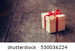 brown gift box and red ribbon... | Shutterstock . vector #530036224