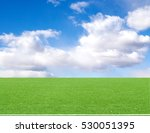 Football Field Blue Sky With...