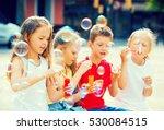 Children Sit At Playground And...