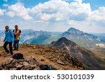 Two Mountain Climbers Enjoying...