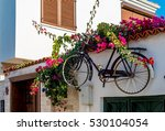 old bicycle used as exterior... | Shutterstock . vector #530104054
