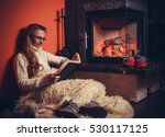 Woman Relaxes By Warm Fire Wit...