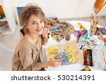Young Female Artist Painting...