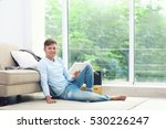 young handsome man reading book ... | Shutterstock . vector #530226247