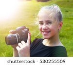 Young Photographer And Reflex...