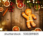 gingerbread man over wood.... | Shutterstock . vector #530289805