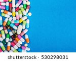 many scattered colorful pills... | Shutterstock . vector #530298031