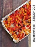 Small photo of Roasted butternut squash, red bell pepper and red onion on baking sheet with aluminum foil