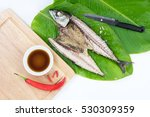 grilled mackerel fish with leaf.... | Shutterstock . vector #530309359