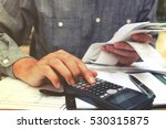man using calculator and... | Shutterstock . vector #530315875