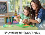 mother teaches kid to do craft... | Shutterstock . vector #530347831