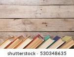 old books on the wooden... | Shutterstock . vector #530348635